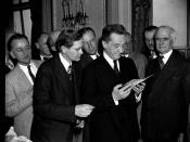 20-Year signature interests Kerensky. Washington, D.C., April 21. Following a talk to members of the National Press Club today, Alexander Kerensky, Head of the Russian Provisional Government of 1917, is shown a passport issued and signed by him to D. Heyw
