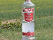 Found this Smirnoff vodka bottle on a old weathered gatepost to a field outside of Avebury.