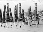 Seattle Potlatch Parade showing people wearing totem pole costumes