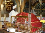 Sikhism Related Photo of a Sikh man in attendance to the Sri Guru Granth Sahib, the Sikh Holy scripture