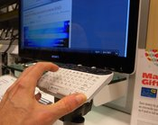 English: Keyboard of Sony Internet TV with hand for scale.