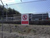 English: Security fence and sewage works, Harwell site. The notices on the fence make it very clear that trespassers are unwelcome. The sign reads