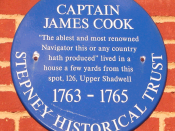 Blue plaque for Captain James Cook located on the wall at 326 The Highway in Shadwell.