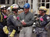 English: FEMA Director Joe Allbaugh meets with Florida Task Force-2 Urban Search and Rescue team members to thank them for their role in the rescue operations underway at the World Trade Center.