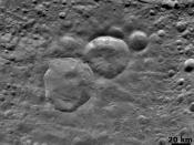 "English: An detailed image, taken by Dawn on August 6, 2011, of three craters on Vesta, which are informally nicknamed ""Snowman"" by the camera's team members. It has a resolution of about 260 meters per pixel."