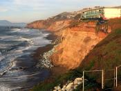 English: On December 17, 2009 30 feet chunk of the cliff below the apartment building fell to Pacific Ocean. Residents were given 20 minutes to evacuate the building. Now the workers are trying to save it.