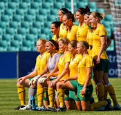 English: The Australia women's national association football team lining up before a friendly against Italy in Sydney.