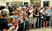 Crowd stand before the Mona Lisa at the Louvre, 2009