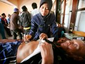 English: An Indonesian nurse examines a patient at a clinic in Baluran, Indonesia.