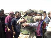 US Navy 030328-A-2018L-008 A member of the Free Iraqi Forces (FIF) is reunited with family members in his home village. Free Iraqi Forces are Shiia and Sunni Muslims, Arabs and Kurds, all exiled from Iraq who are committed to