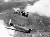 A U.S. Marine Corps North American SNJ-3 Texan and a Curtiss SBC-4 Helldiver ssigned to the First Marine Air Wing in flight in early 1942.