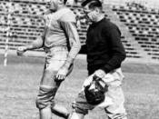 Claude Simons, Sr. aiding a Tulane football player as the team athletic trainer.