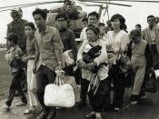 South Vietnamese refugees walk across a U.S. Navy vessel. Operation Frequent Wind, the final operation in Saigon, began April 29, 1975. During a nearly constant barrage of explosions, the Marines loaded American and Vietnamese civilians, who feared for th