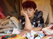 English: Crop of File:Souvenir Seller - Moscow - Russia.JPG focusing on woman.