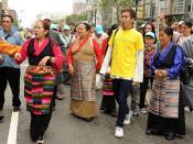 Tibetan people begin to walk, traditional chubas on women and men, birthday t-shirt, Happy Birthday to His Holiness the Dalai Lama, Tibetans at Kalachakra, Washington D.C., USA