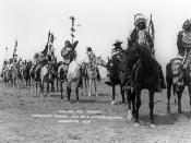 Procession of men of the Blackfoot Confederacy on horseback