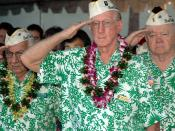 English: Pearl Harbor, Hawaii (Dec. 7, 2005) – Pearl Harbor survivors salute the National Ensign during the 64th commemoration of the Dec. 7, 1941 attack on Pearl Harbor, Hawaii. The ceremony, which included remarks by keynote speaker Chief of Naval