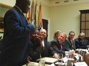 English: President George W. Bush listens to Robert Sutton, left, a graduate of the Prison Fellowship Ministries InnerChange Freedom Initiative, during a roundtable discussion in the Roosevelt Room Wednesday, June 18, 2003. The initiative is is part of th