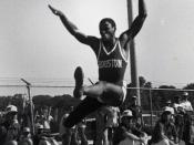English: Carl Lewis in midair during a long jump for track and field as an athlete at the University of Houston