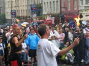 A street performer on the Royal Mile, with volunteer (2004).