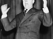 Senator Huey P. Long of Louisiana, half-length portrait, standing, facing left, gesturing with both arms, as he speaks.