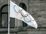 English: The Olympic Flag flying in Victoria, British Columbia, Canada, outside the provincial legislature of British Columbia, in recognition of Vancouver's hosting of the 2010 Winter Olympic Games