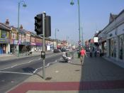 English: Shirley High Street, Southampton. Looking northwest along Shirley High Street just after the shops have opened on a weekday.
