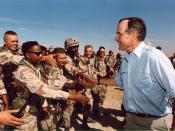 President Bush visiting American troops in Saudi Arabia on Thanksgiving Day, 1990.