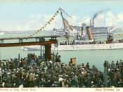Arrival of Rex, monarch of Mardi Gras, as seen on an early 20th century postcard