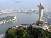 Cristo Redentor statue on top of Corcovado, a mountain towering over Rio de Janeiro. In the background the Ipanema and Leblon beaches separate the lagoon from the Atlantic Ocean.