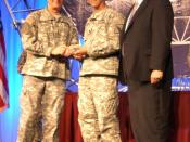 English: Lt. Gen. Jeffrey A. Sorenson, Army Chief Information Officer (CIO)/G-6 (left) presented a Knowledge Management award to Lt. Col. Michael Rodriguez, director Battle Command and Network Support Directorate (BCNSD) (center) with John Wilder, deputy