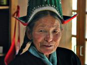 A woman from Ladakh province, Jammu and Kashmir, India. She wears a traditional Ladakhi dress and hat.