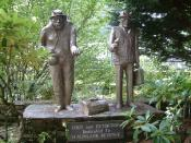 English: Loot and Extortion. Statues at Trago Mills, poking fun at the Inland Revenue.