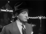 English: Bruno Anthony (Robert Walker) in line for the Tunnel of Love in Alfred Hitchcock's 1951 Strangers on a Train (trailer)