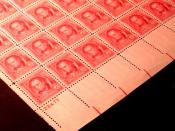 English: Sheet of US Postage stamps, 1940 issue, partial image, featuring perforations.