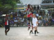 Action from a 1999 Aussie rules football match in Nauru at the Linkbelt Oval
