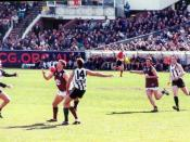 Australian Rules football at the Melbourne Cricket Ground. The player taking the mark is Alastair Lynch of the Brisbane Lions, against Collingwood Football Club. Photo taken August 2003 by User:Robert Merkel and placed in the public domain by the photogra