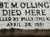 A grave marker indicating that the deceased was killed by Billy the Kid