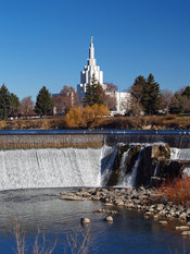 Idaho Falls on the Snake River with the Idaho Falls Idaho Temple in the background