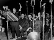 At an Italian-American Labor Council concert in Madison Square Garden on February 1, 1942, Mayor Fiorello LaGuardia shows a fundraising check that will be donated to the Red Cross for war relief.  Also present are Luigi Antonini, Joseph Catalanotti, and C