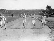 James Ball of Canada (left) winning a silver medal in the men's 400m. race at the VIIIth Summer Olympic Games