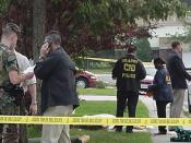 Soldiers of the United States Army Criminal Investigation Division inspecting a crime scene.