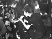 Crass were the originators of anarcho-punk. Wells (2004), p. 35. Their all-black militaristic dress became a staple of the genre.