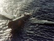 English: Crashed Japanese Bomber floating at Tulagi Photo #: 80-G-K-383 (Color)