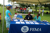 English: New Orleans, LA, June 14, 2008 -- Shelia Forest, CEO Specialist (L) and Shelia Moore, NFIP Specialist (R) talk with event attendee about the steps that can be taken to mitigate a residence from future disasters. The two staff members manned the F