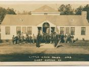 Soldiers standing in front of Little White House, Camp Gordon, GA, circa 1917