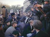 Members of the military are attempting to keep Vietnam War protesters under control.