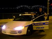 English: this photo is of a Memphis Police Squad car and officer (me, taken by my wife) with the Hernando de Soto bridge in the background. This photo was taken of me, by my wife.