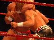 Chris Masters locks Shawn Michaels in a headlock during a WWE house show held at the MEN Arena in Manchester, United Kingdom on November 17, 2005.