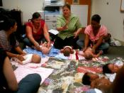 English: PEARL HARBOR (April 23, 2010) Mara MacDonald, from the Navy New Parent Support Home Visitation Program, leads a group of new mothers and their babies in an infant massage class. The program is administered by the Navy Region Hawaii Fleet & Family